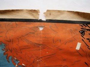 restauration d'affiche, détail trou